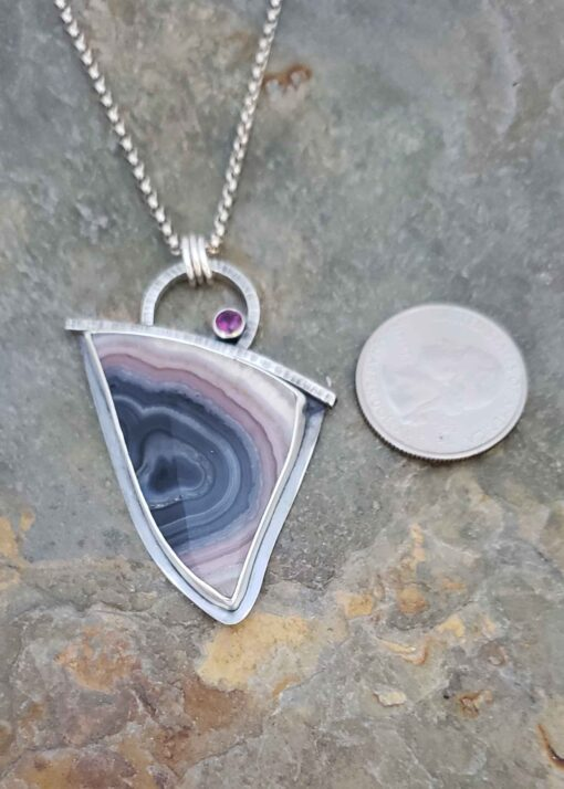 Layers of pinks and blues in this silver pendant.