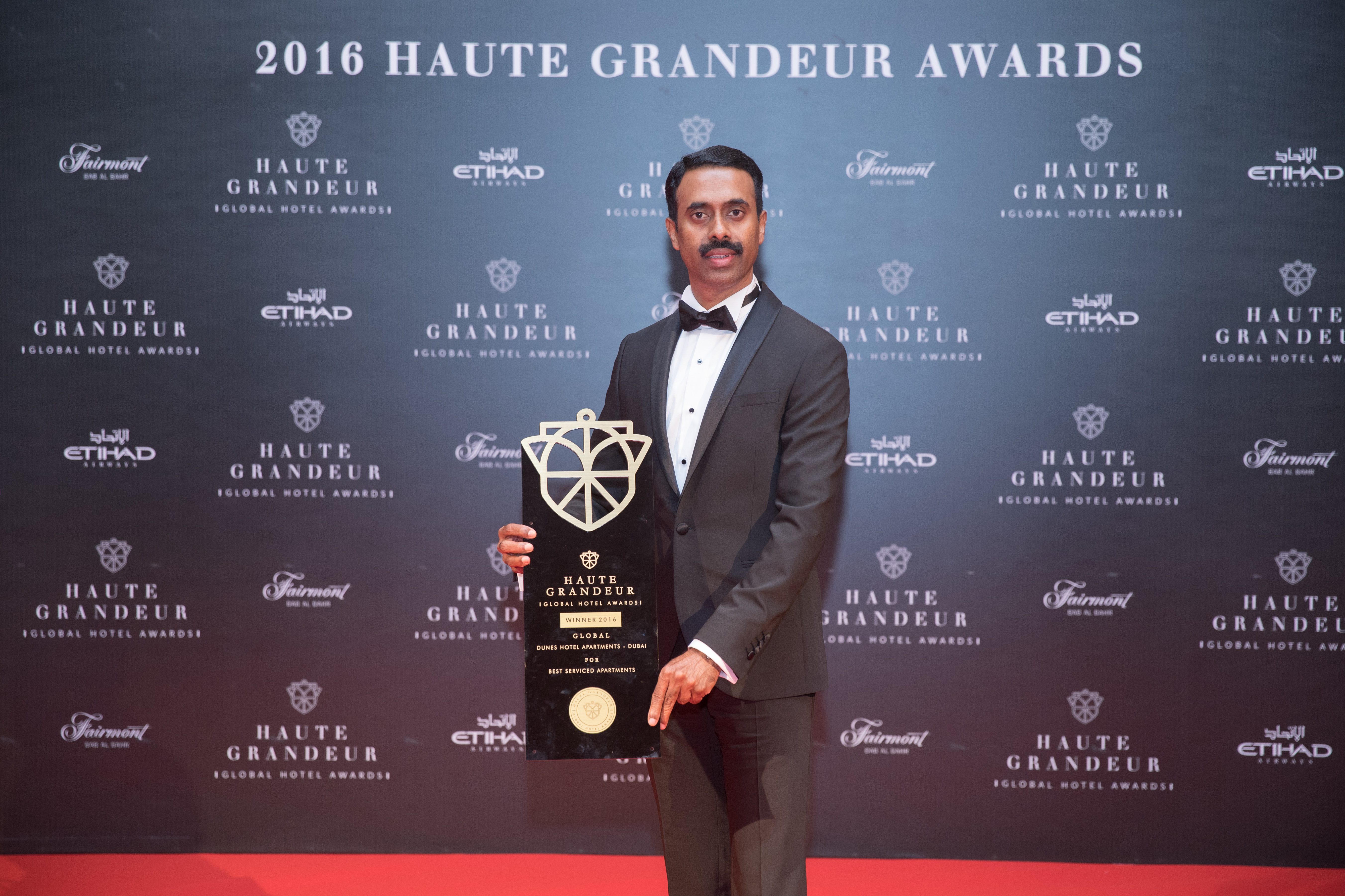 Faisal Abdul Rahman, General Manager, Dunes Hotel Apartments with the awards