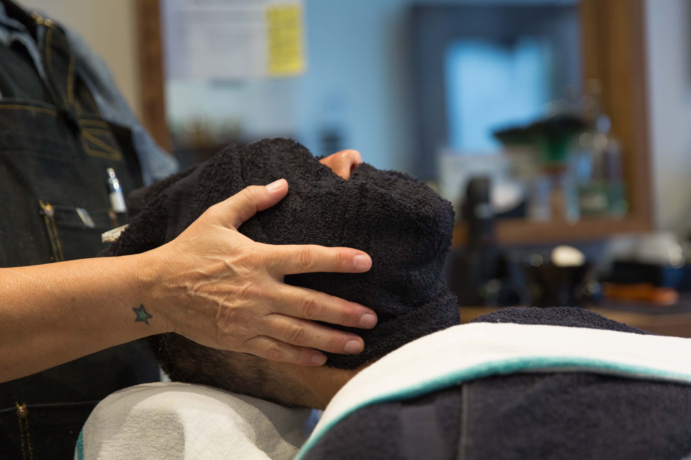 Hot towel on client's face