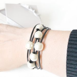 Black Leather Pearl Bracelet on wrist. The large white pearls really make a statement.