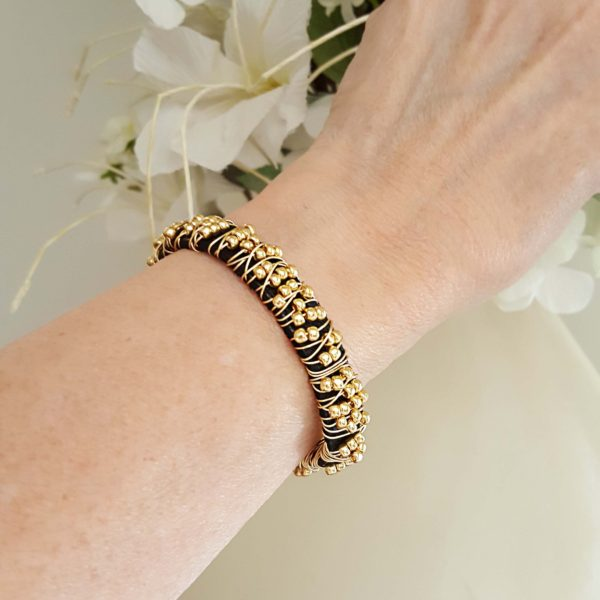 Wire Wrapped Leather Bracelet on the wrist shows the latest trend in stacking.