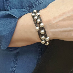 Black Leather and Silver Bead Bracelet for women showing how great it looks on your wrist.