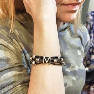 Personalized black leather bracelet with silver M initial.