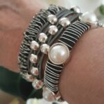 Gray stack bracelet set. Wire wrapped, leather cords with silver beads and wire wrapped with cabochon pearls.