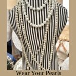 Pearl necklaces on display in store.