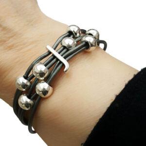 Initial Bracelet J Grey Leather on wrist.