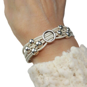 Initial O White Leather Bracelet on wrist.