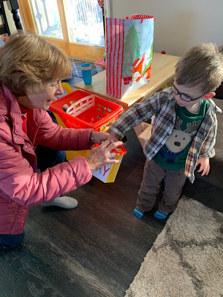 A volunteer brings joy to this young boy