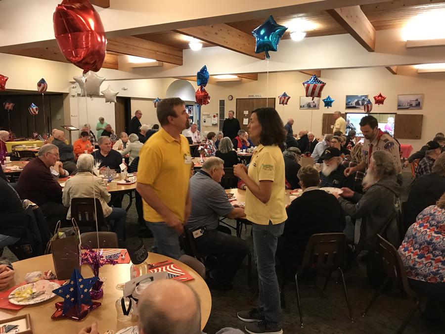 Volunteers provide a Veterans Dinner every November