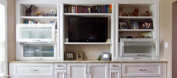 white entertainment center showing how the cabinet doors slide upwards