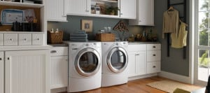 spacious laundry room with white cabinets