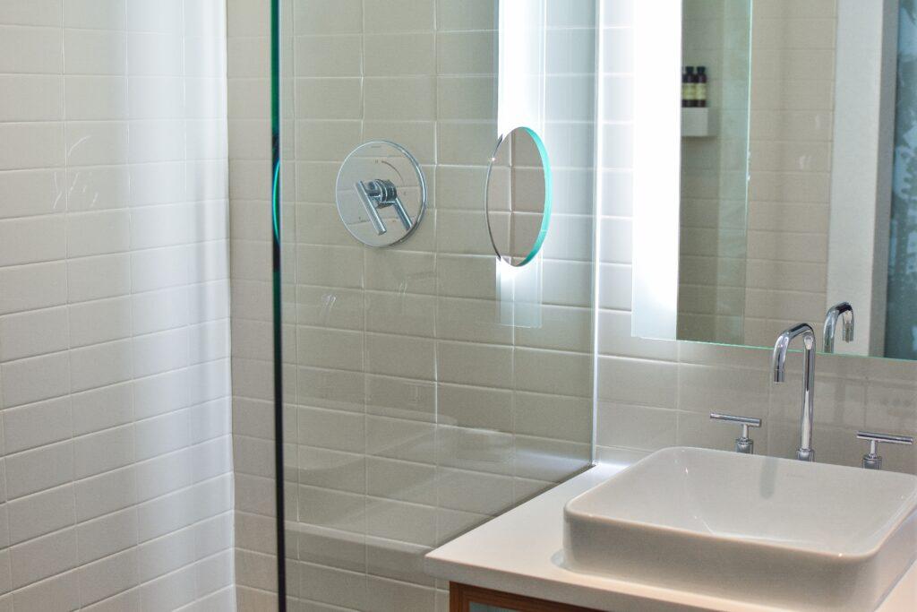 Brighten up a dark bathroom with backlit mirros