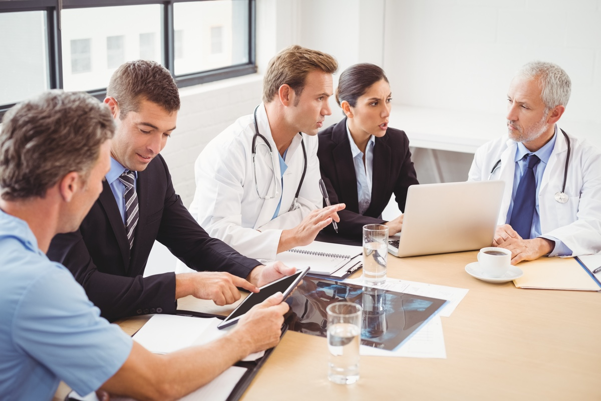 Medical sales reps meeting with doctors