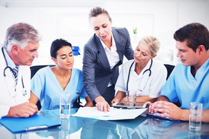 medical rep consulting with customers