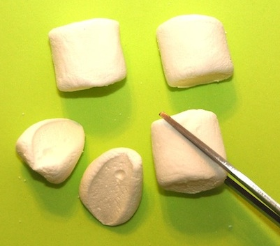 Marshmallows cut on the diagonal l then dipped in colored sugar make great bunny ears.