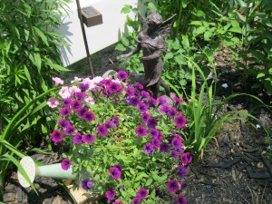 The blooms are bountiful in this container garden I made using an old watering can.