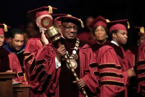 Dr. Edison O. Jackson holds the mace during his inauguration as President of Bethune-Cookman University at the Performing Arts Center, in Daytona Beach, October 16, 2013. (Photo credit: News-Journal/David Massey)