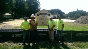 Four Tucker Paving workers stand in front of the job site