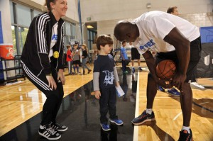 Magic Community Ambassador Bo Outlaw visits with youth and families at the Magic and UnitedHealthcare's Fit Fest 2015 on Jan. 10. (Photo credit: Gary Bassing.)