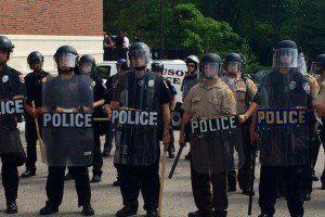 Ferguson police officers in riot gear (Photo credit: Twitter/LauraKHettiger)