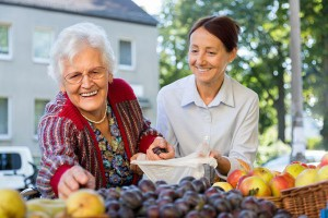Senior Woman Shopping with Caregiver