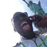Audio Tour goofy face under Lady Liberty