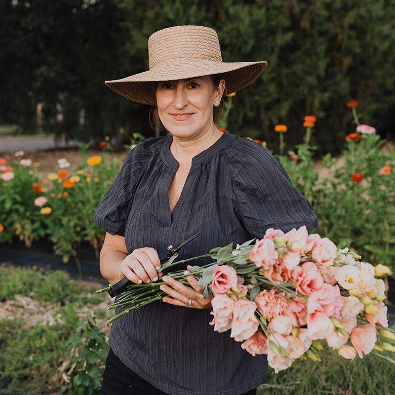 Lisa Thibodeau holding flowers