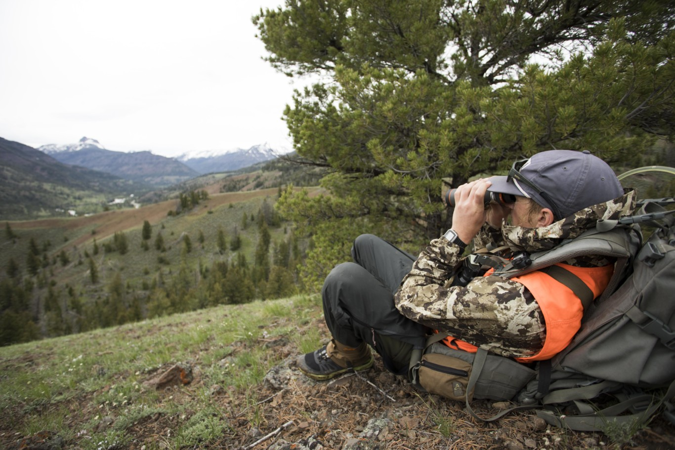 Landon Blanchard watches a grizzly bear in Wyoming - Photo by: Christian Baumeister