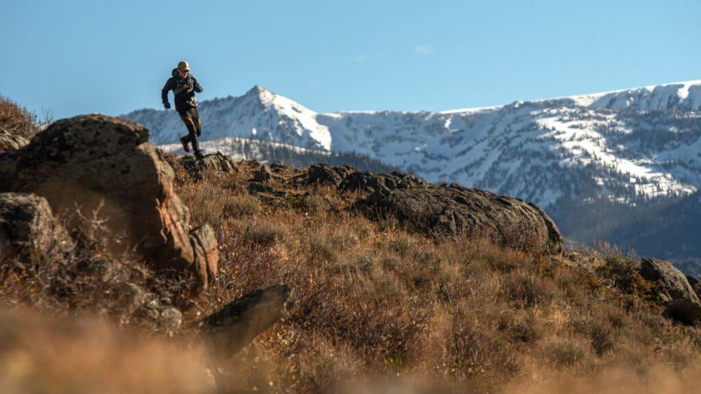 Pat Rodgers Running with Mount Zirkel Wilderness in Background