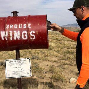 Edgar Castillo putting wings in barrel