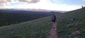 Kelly hikes along a path
