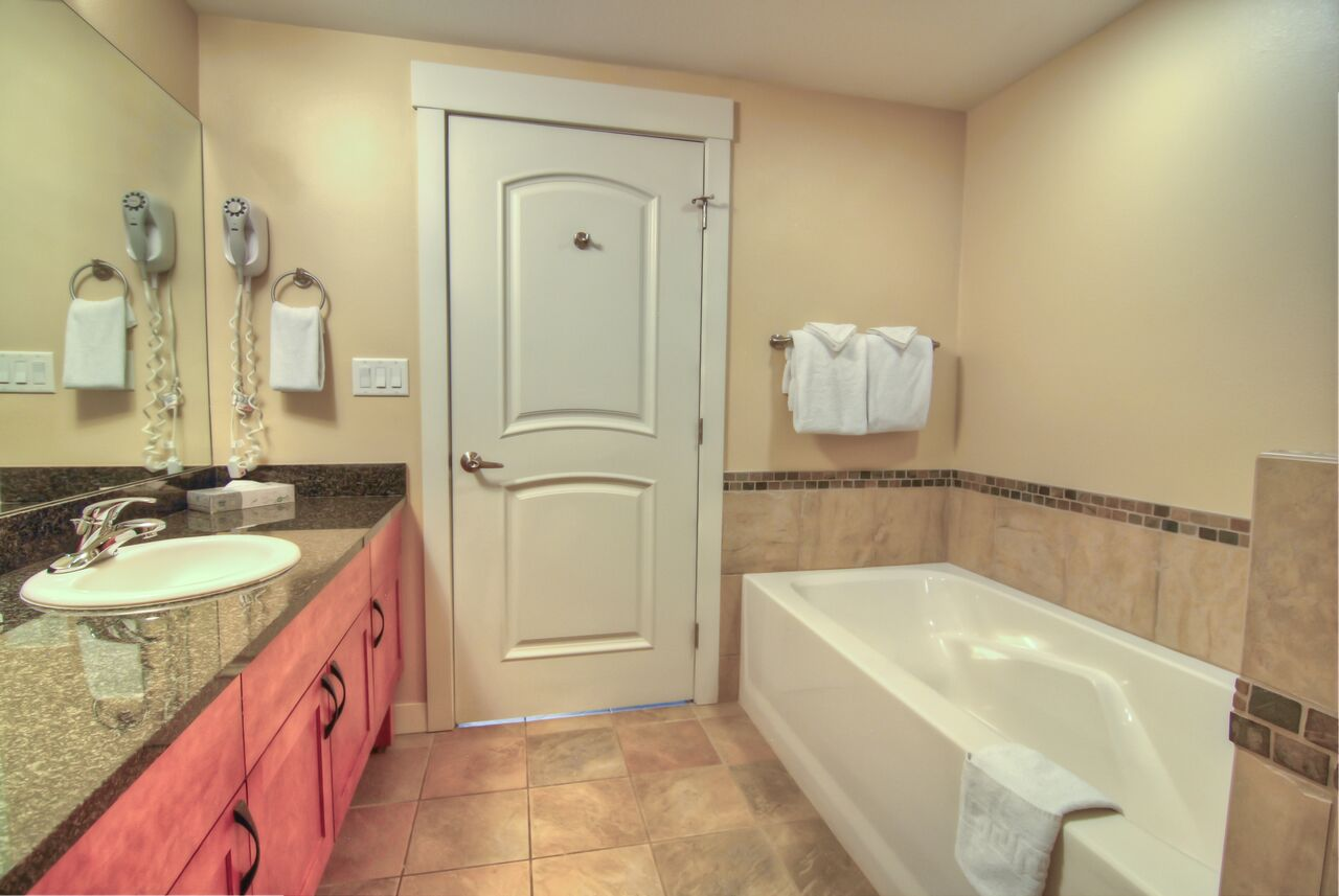 one bedroom silver kitchenette bathroom