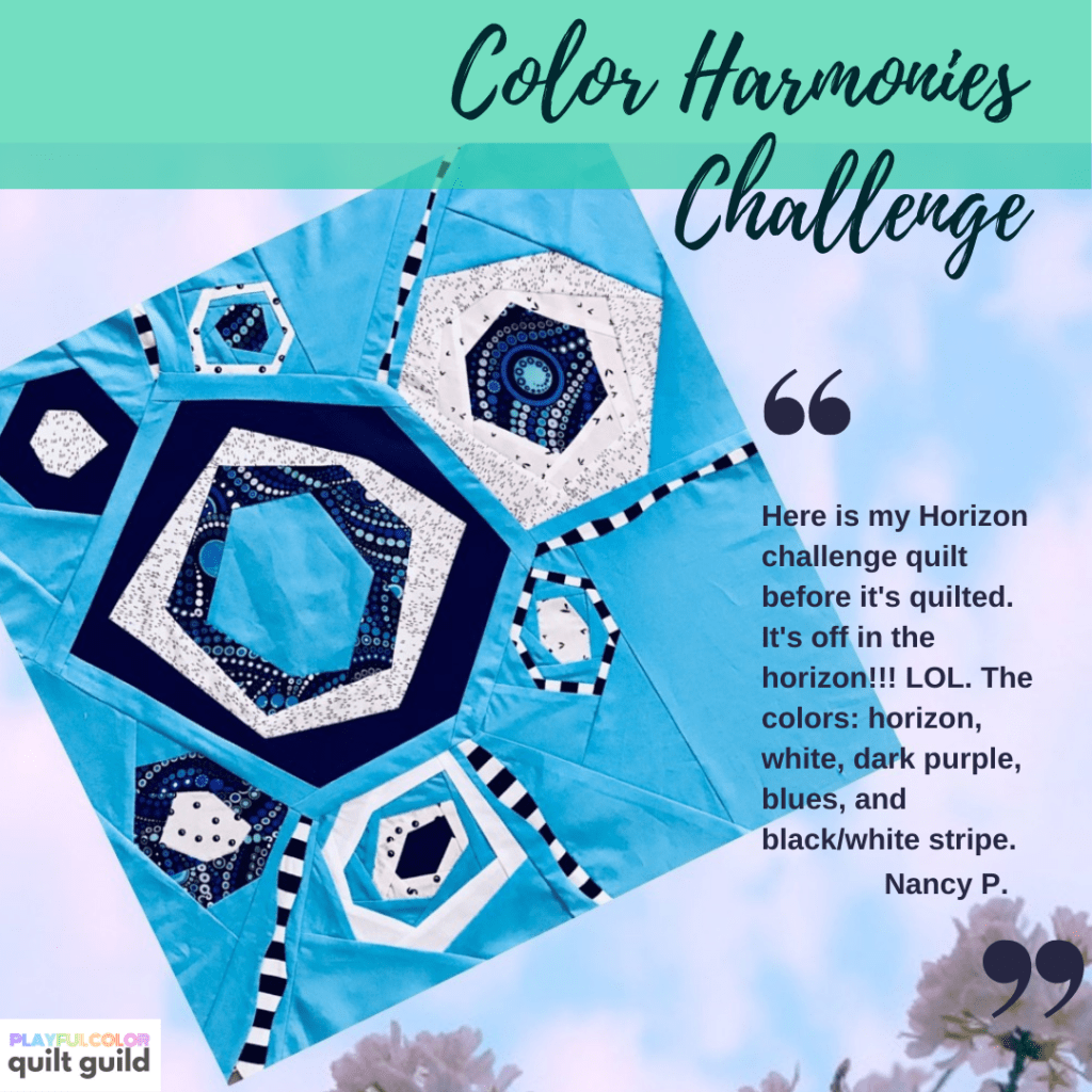 Photo of an improvisational style quilt block made with blue and purple fabrics with white and black accents, forming an analogous color harmony.