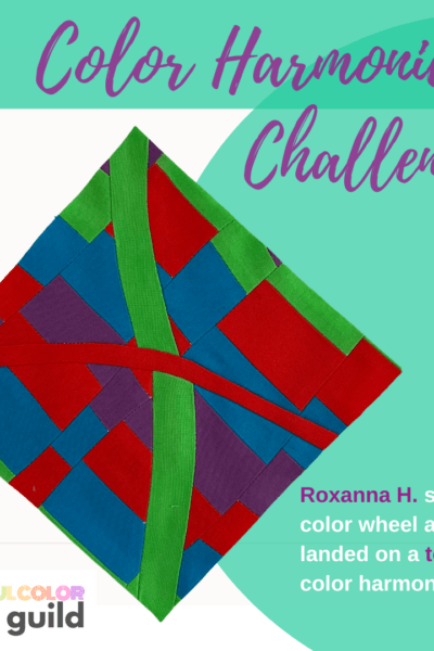 Improvisational quilt block made with purple, green, blue and red fabrics in wonky shapes.