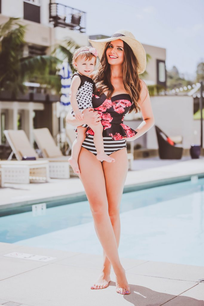 Irina Bond, mom and baby, pool, The Beach People Tulum Roundie Towel, Albion Fit Floral Tankini, Straw Floppy Hat