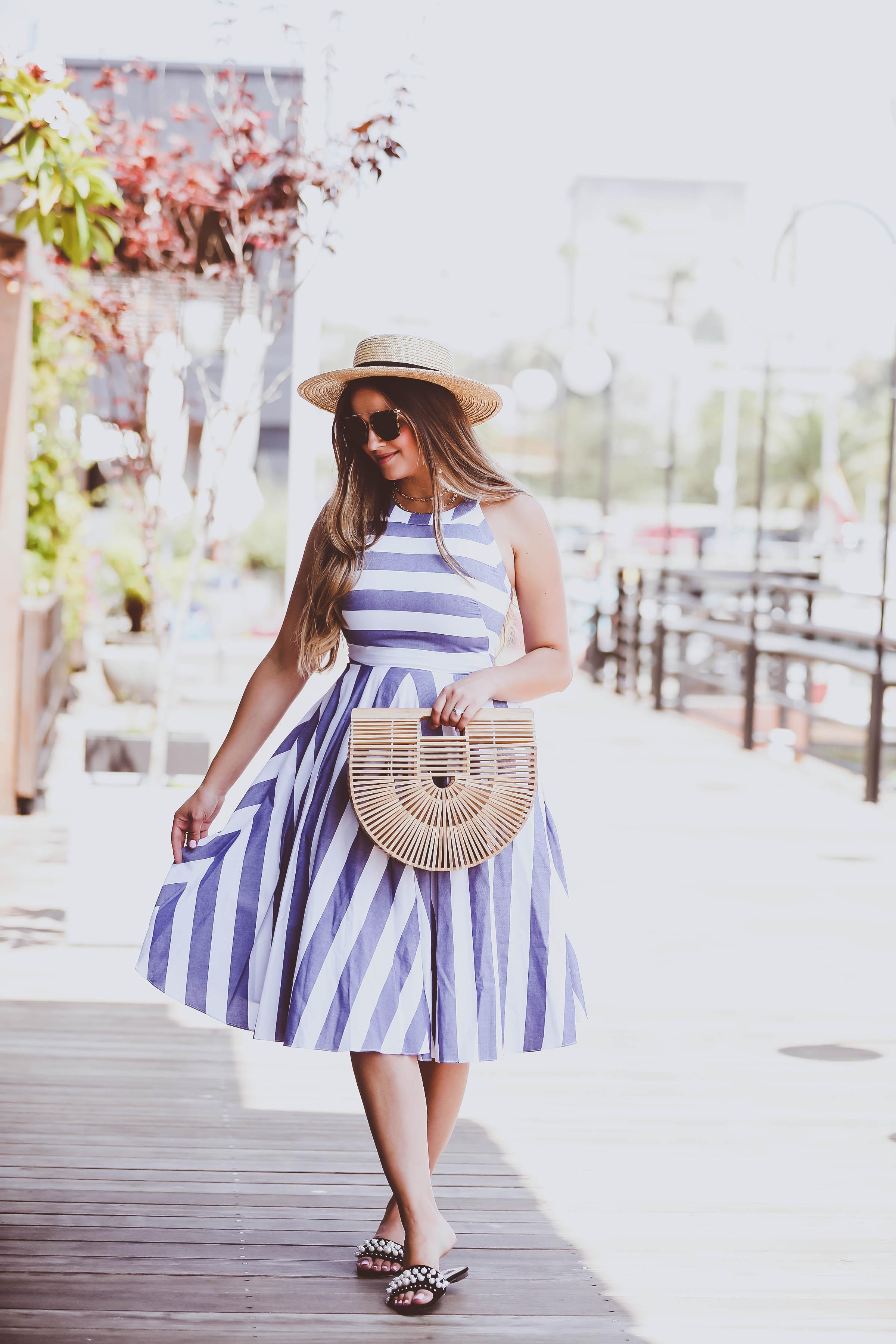 eliza j dresses blue & white halter dress, cult gaia bamboo ark bag, stokke xplory stroller, pearl slides, straw boater hat