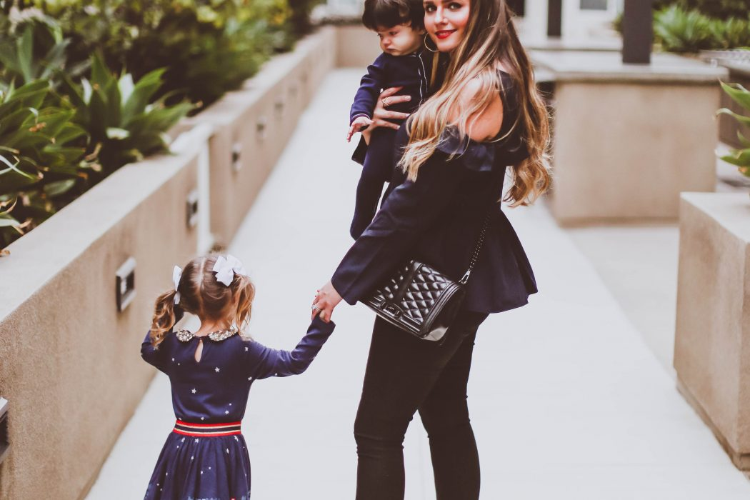 fall outfit ideas, fall style, bp cold shoulder ruffle blouse, nordstrom young customer department, brass plum, mommy fashion blogger, marc fisher grazie sequin bootie, jen7 coated black skinny jeans, rebecca minkoff love cross body bag, mini boden toddler girl dress, livie and luca bunny shoes, baby boy ralph lauren navy footie