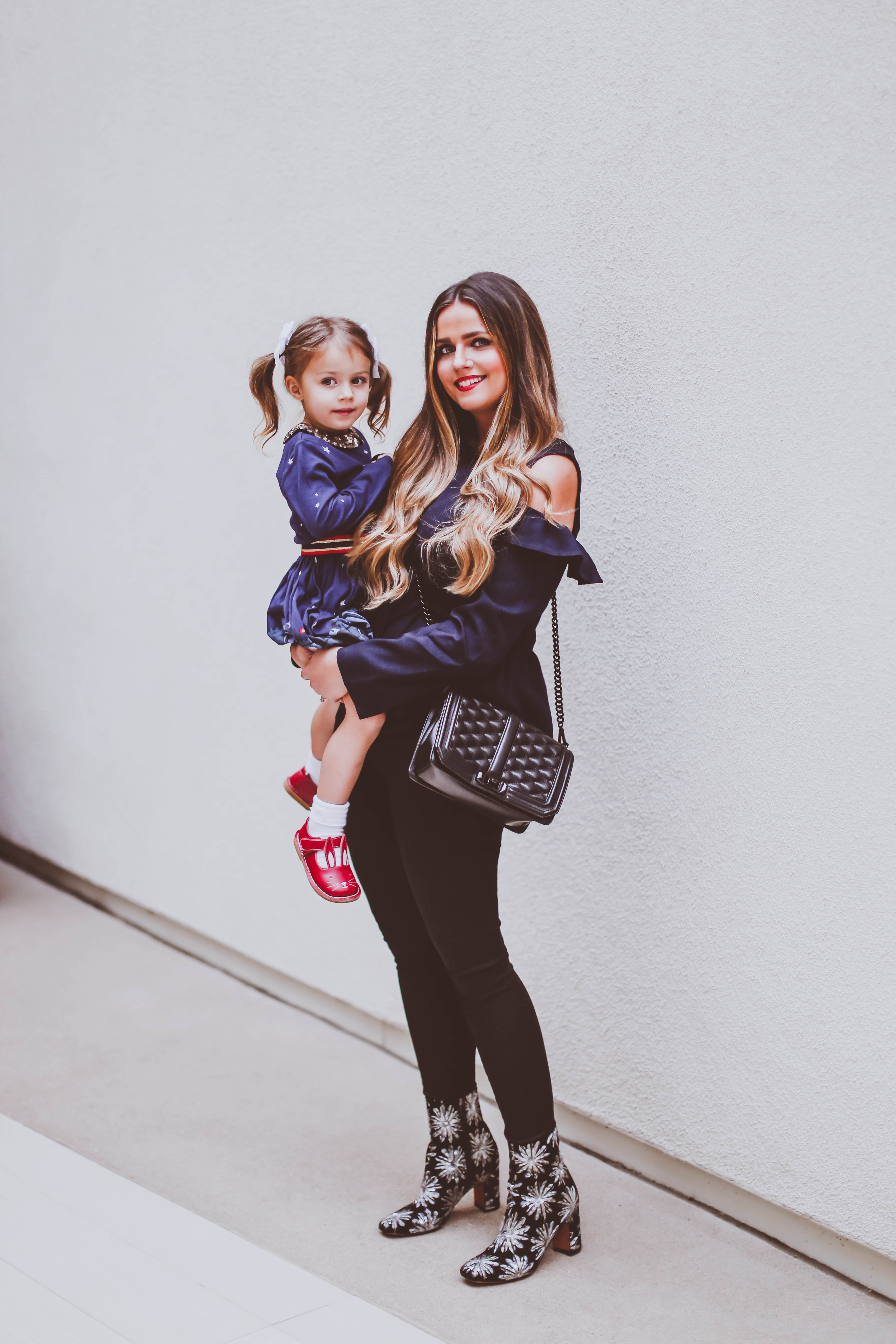 fall outfit ideas, fall style, bp cold shoulder ruffle blouse, nordstrom young customer department, brass plum, mommy fashion blogger, marc fisher grazie sequin bootie, jen7 coated black skinny jeans, rebecca minkoff love cross body bag, mini boden toddler girl dress, livie and luca bunny shoes