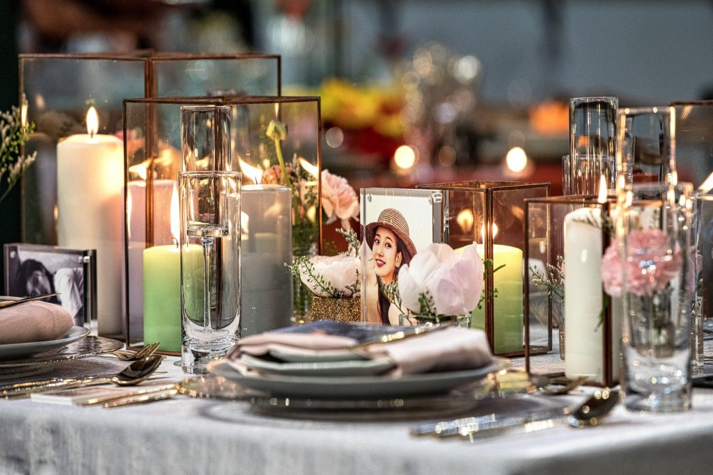 Tabletop shot of plates and candles along the middle