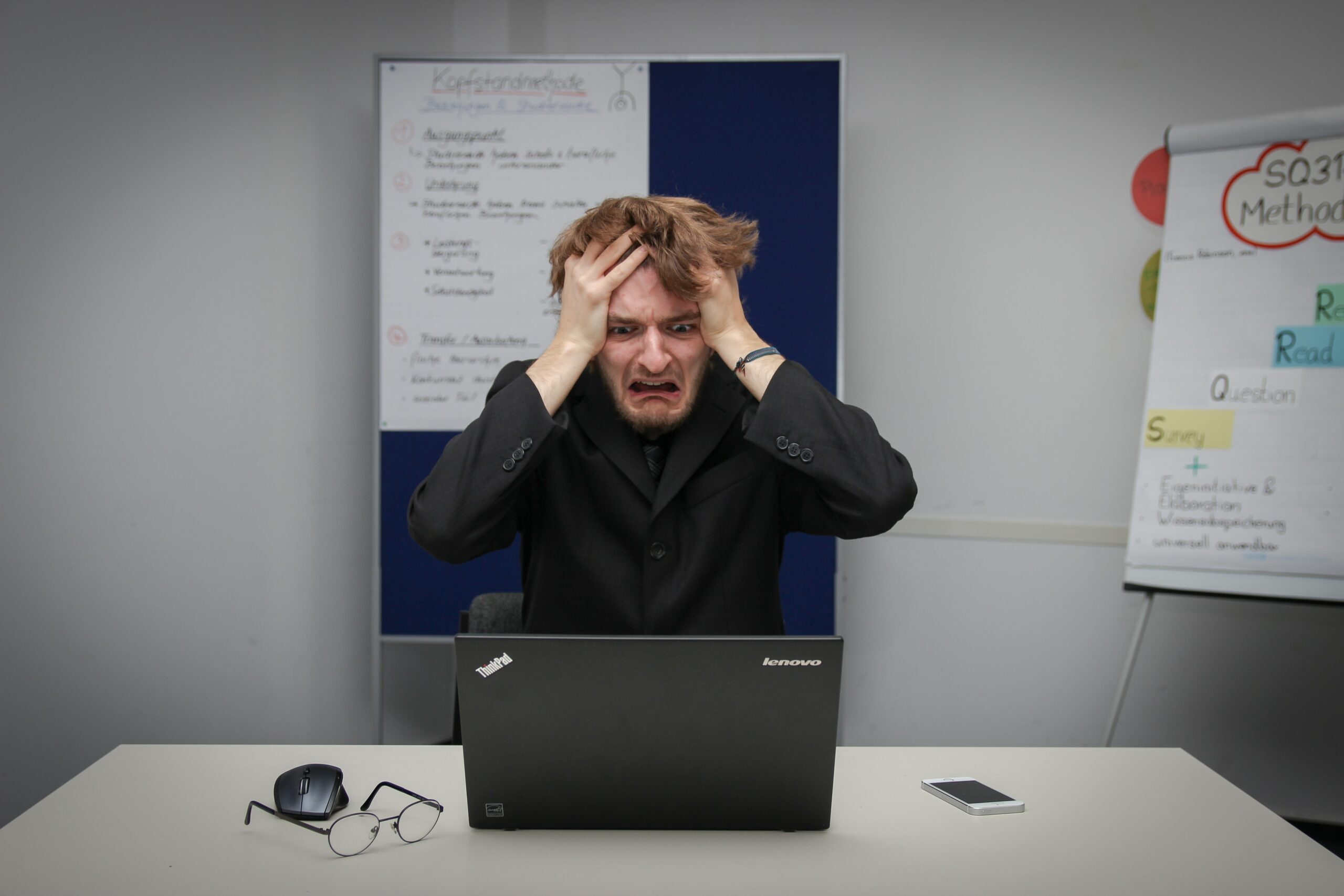 person terified at the sight of his computer