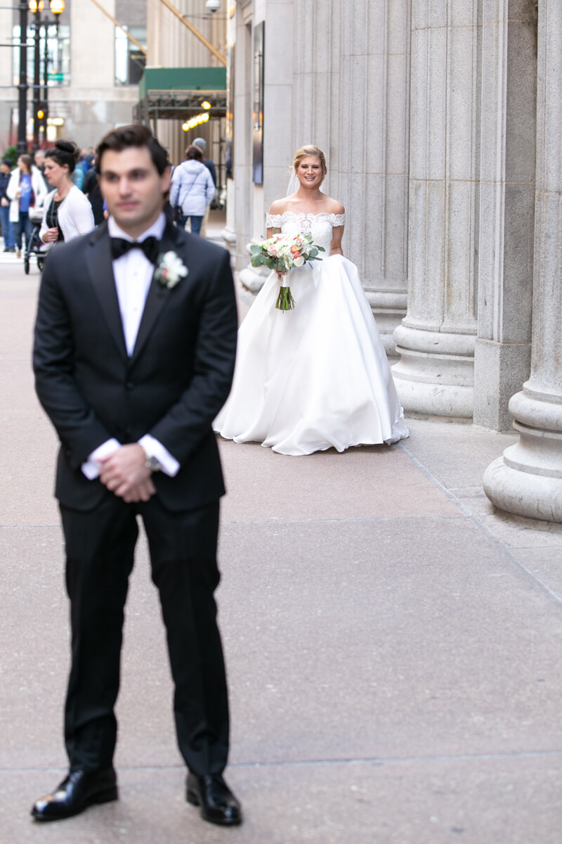 Groom anticipates first view of bride