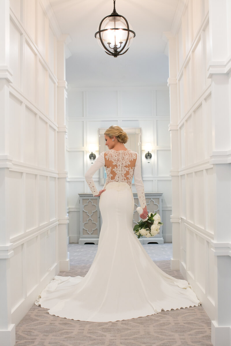 White backdrop at hotel for bridal portrait