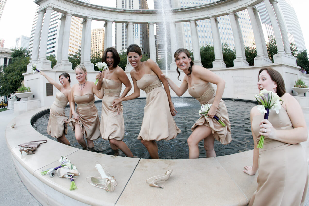 Bridesmaids jump into the fountain at Chicago's Millennium park