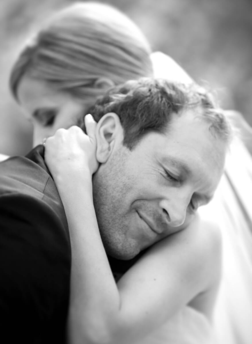 Black and white emotional image of groom