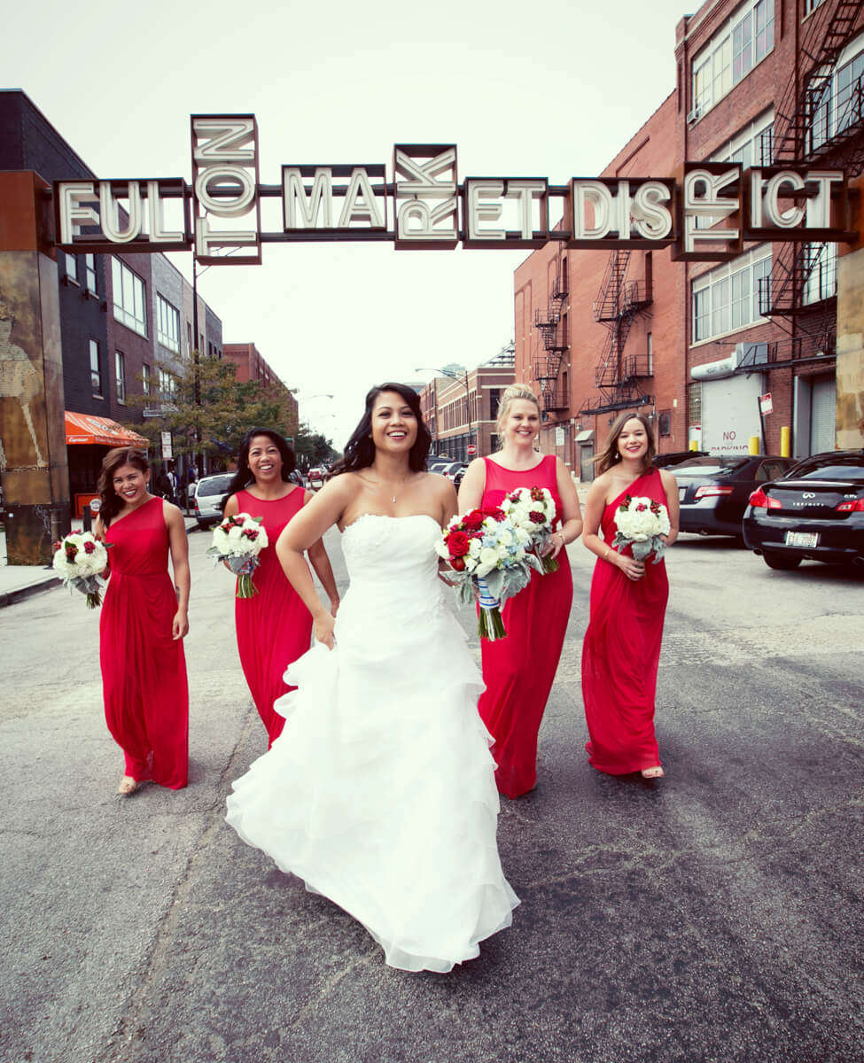 Candid photo of bride and bridesmaid at Fulton Market District