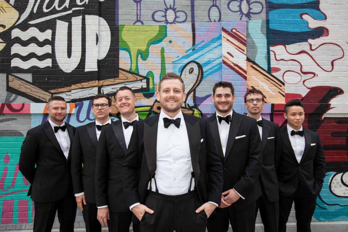 Creative Graffiti backdrop for groomsmen pose