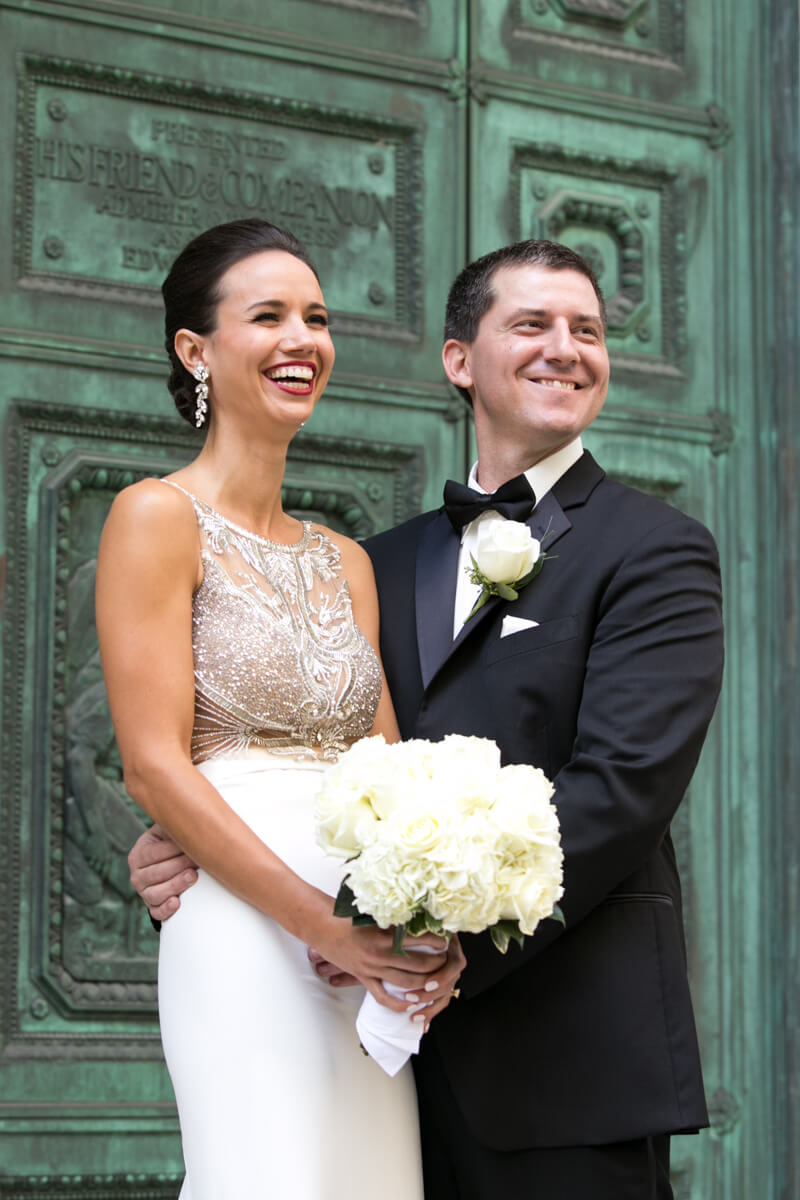 Bride and groom pose in front of Murphy Auditorium's Green Doors