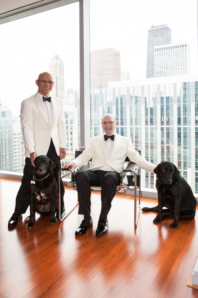 Classic portrait of grooms with their dogs