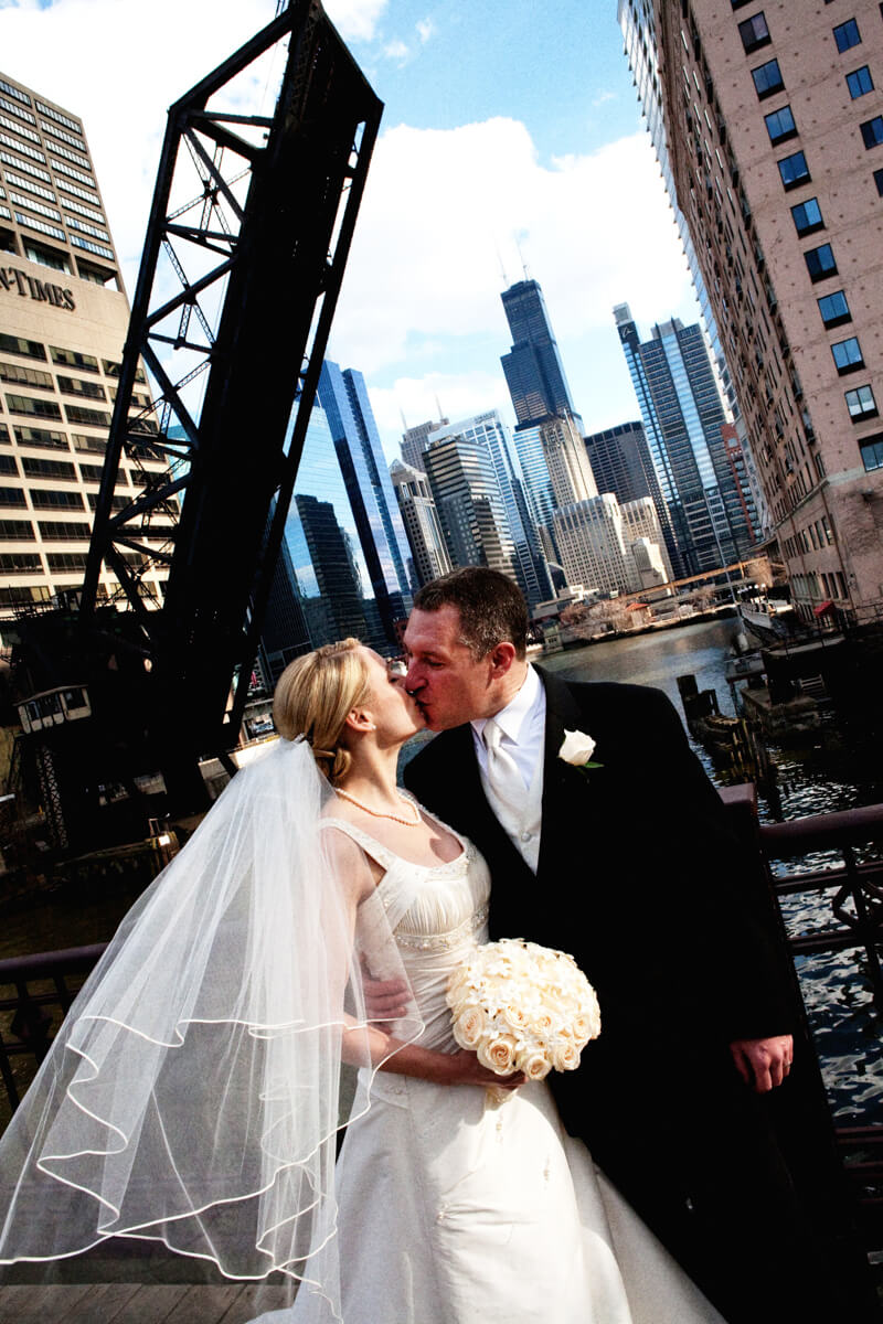 Kinzie Street Bridge portrait with bride and groom in Chicago