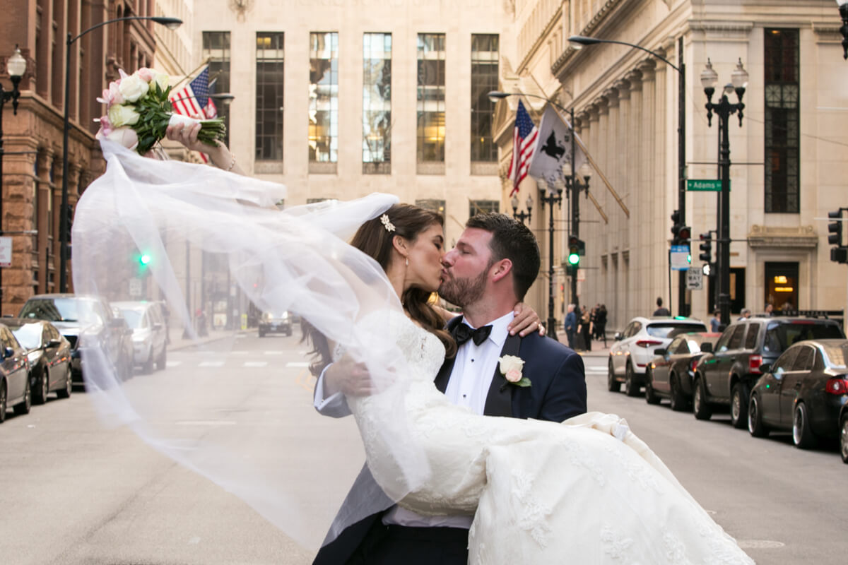 Bride's veil flows in beautiful photo on LaSalle Street in Chicago